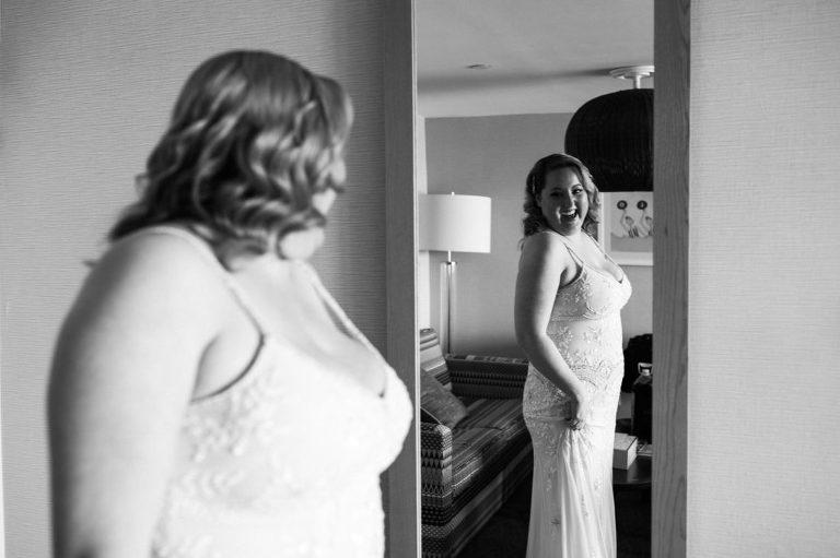 Bride getting ready for her elopement at the Dream Inn in Santa Cruz, California
